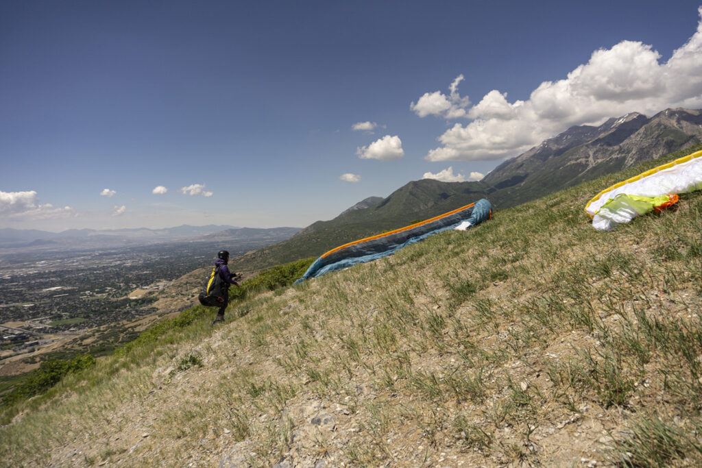 About to launch a paraglider from Inspiration Point